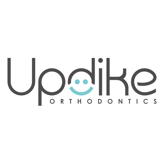 The Updike Orthodontics logo where the O is a smile